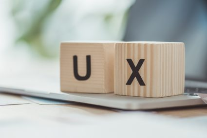 Two wooden blocks. One in letter